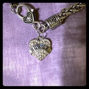 Sterling silver charm bracelet with the nurse